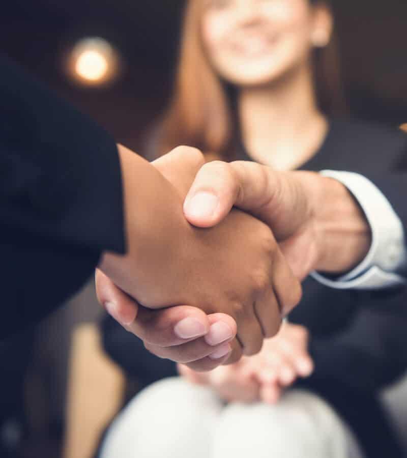 businessmen shaking hands after meeting