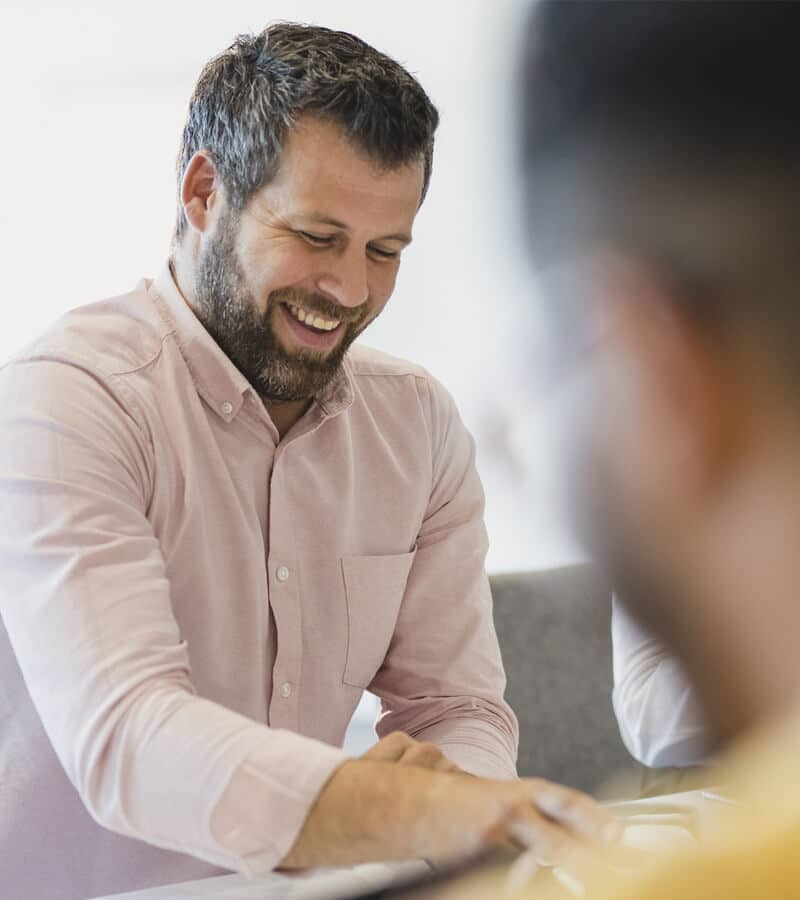 cheerful mature businessman smiling in meeting